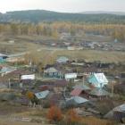 Вид на деревню с холма, на котором стоит часовня
